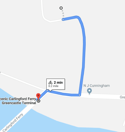 Route to Greencastle Royal Castle, or turn left for great views of the Lough