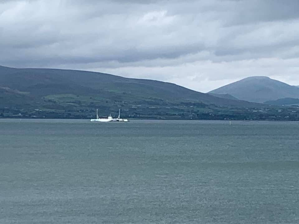 Carlingford Lough Ferry and the Mourne Mountains beyond